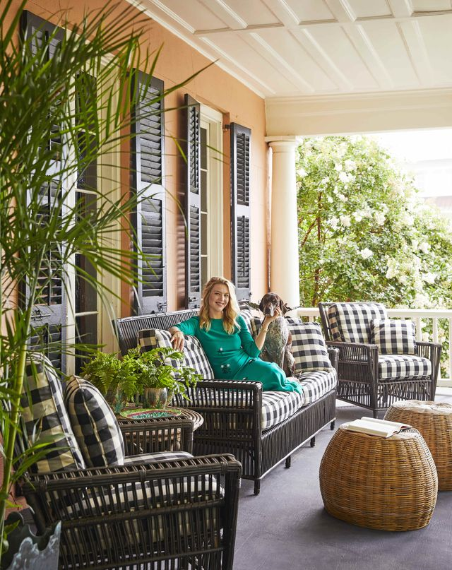 designer ceara donnelley sits on the porch of her charleston home wither her dog