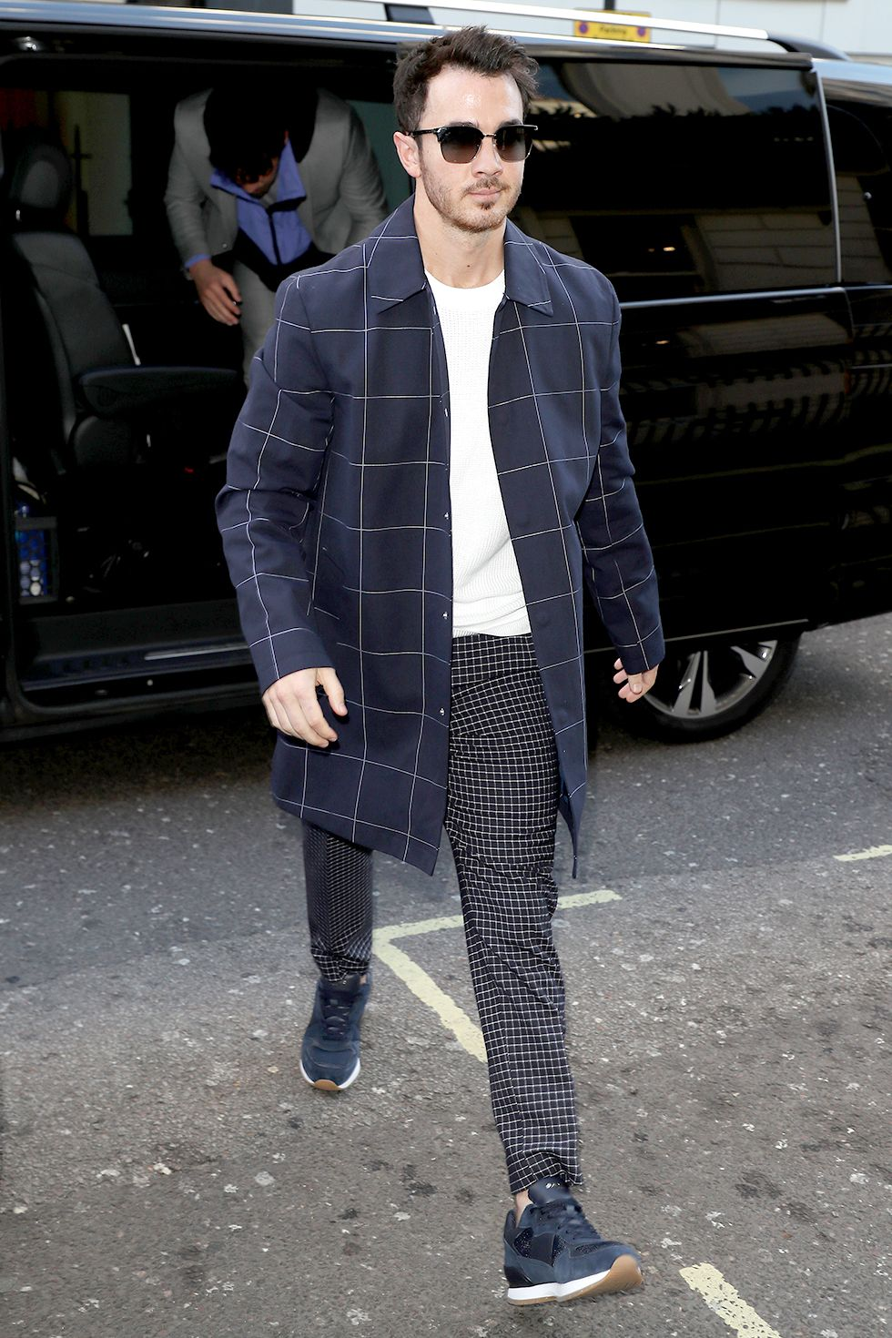Kevin Jonas The oldest Jonas has been inching into the fashion world and we are ready for it. A white top and long, light jacket are perfect for spring.