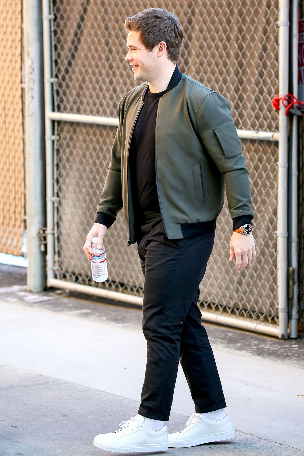 Adam DeVine There's nothing wrong with keeping it simple. A T-shirt, chinos, and sneakers make a great foundation for any lightweight jacket.