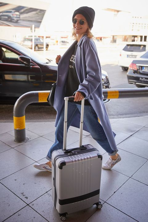 Baggage, Suitcase, Hand luggage, Standing, Shoulder, Street fashion, Travel, Luggage and bags, Outerwear, Cleaner,