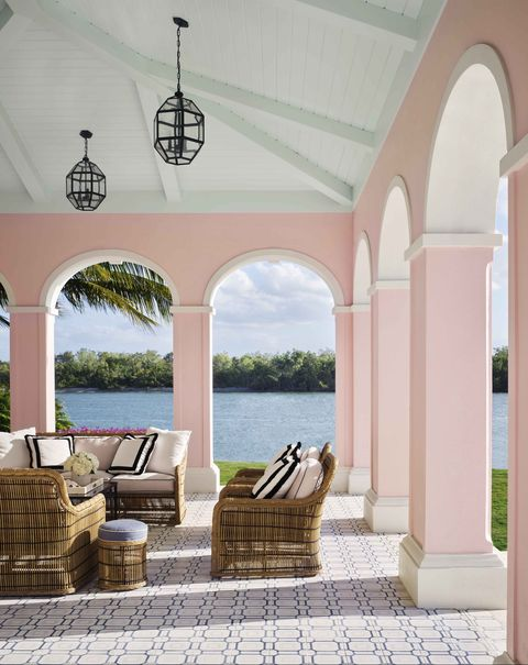 pink stucco terrace on the water in naples, florida