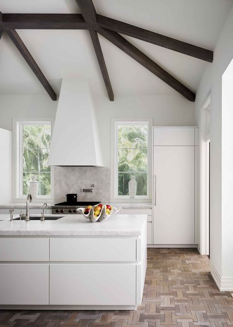 a crisp white kitchen with wood floors