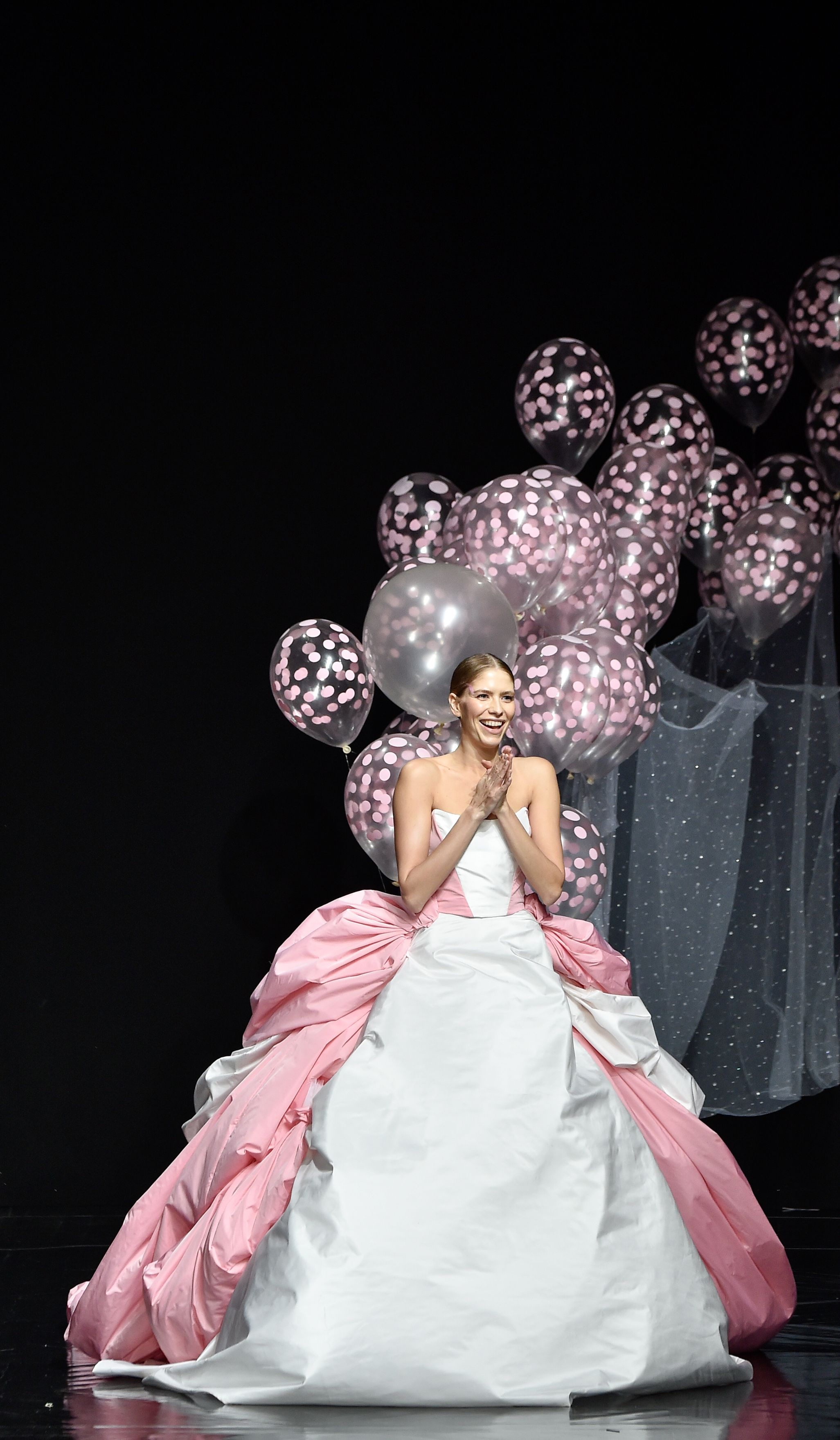 a19edf2a84 Model closes the Celia Kritharioti haute couture show with a balloon-lifted  veil