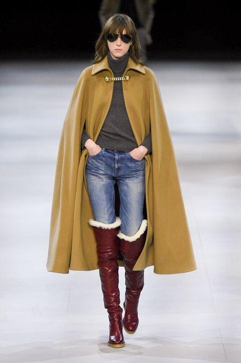 Fashion show, Fashion model, Fashion, Clothing, Runway, Outerwear, Jeans, Yellow, Shoulder, Footwear,