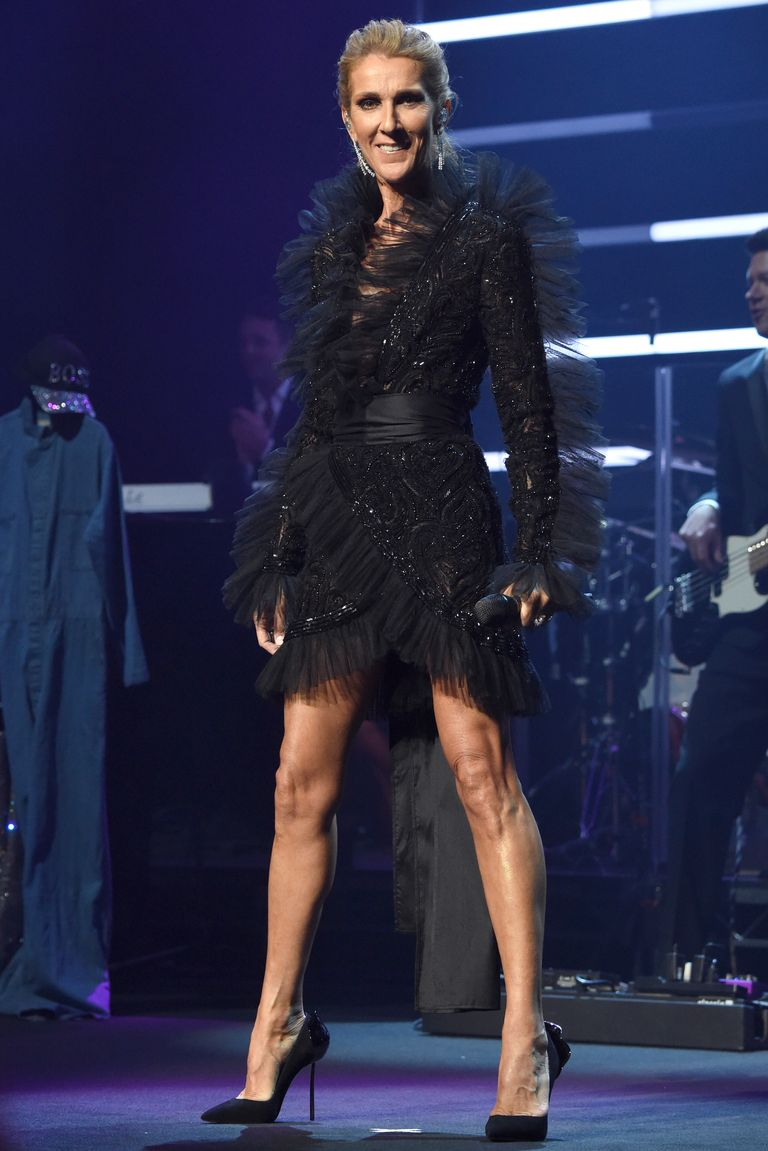 "For her ""Courage"" world tour announcement, Celine chose a black wrap dress with intricate beading and a pair of black pumps."