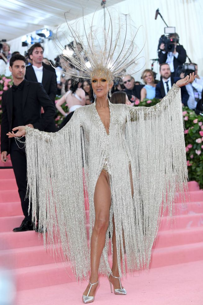"The singer arrived to the 2019 Met Gala in a stunning glittery leotard and headpiece, hitting the nail on the head for this year's theme, ""CAMP: Notes on Fashion."""