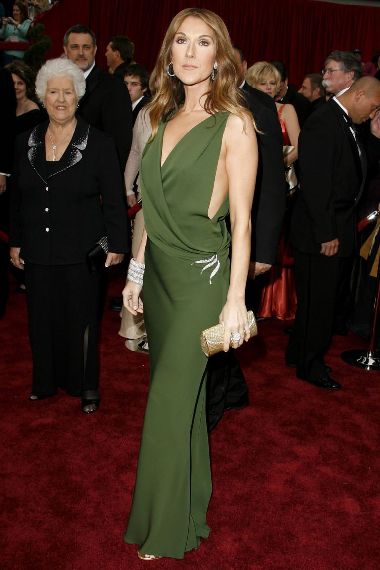 A goddess in green, Celine turned heads on the red carpet wearing a deep-V wrap dress. She tastefully mixed metals in her accessories, with silver jewelry and a gold clutch.