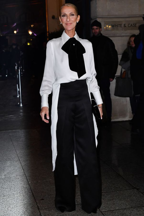 You simply can't go wrong with a black and white ensemble. During Paris Fashion Week, the singer wore a pussy bow blouse with wide leg trousers, a sleek black clutch, and pearl earrings.