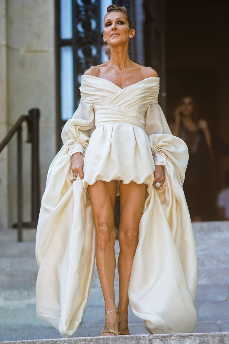 Dion looked simply angelic in an ivory draped minidress during Paris Fashion Week. Her accessories were small yet mighty and her gold strappy heels added the perfect finishing touch.