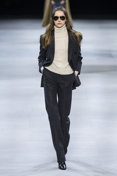 Fashion model, Fashion show, Fashion, Clothing, Runway, Shoulder, Waist, Eyewear, Long hair, Human,