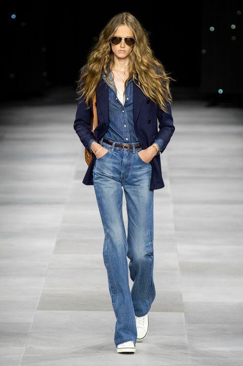 Fashion model, Fashion show, Jeans, Denim, Clothing, Fashion, Runway, Waist, Electric blue, Textile,