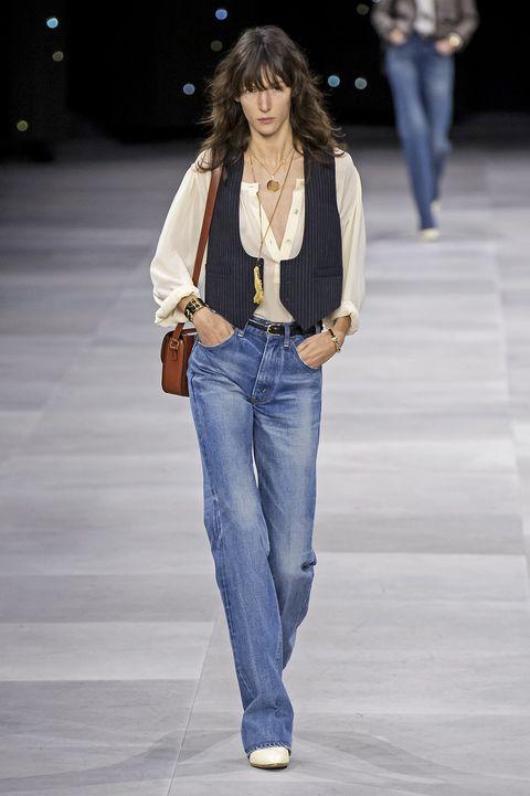 Fashion model, Jeans, Fashion show, Denim, Clothing, Fashion, Runway, Waist, Textile, Outerwear,