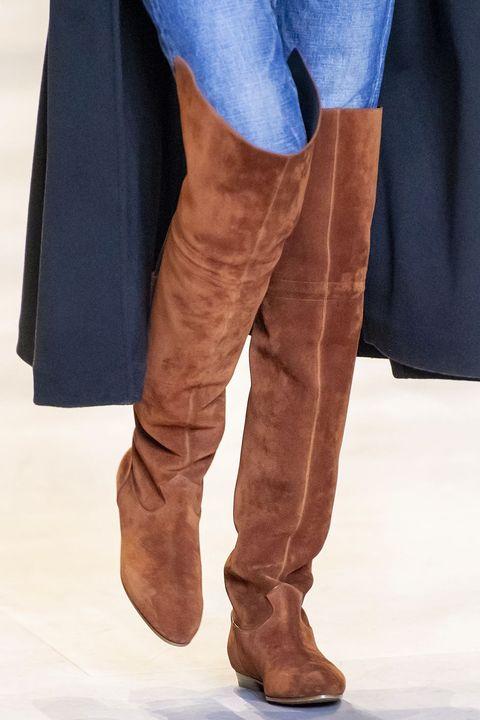 Brown, Sleeve, Human leg, Textile, Standing, Denim, Electric blue, Tan, Liver, Khaki,
