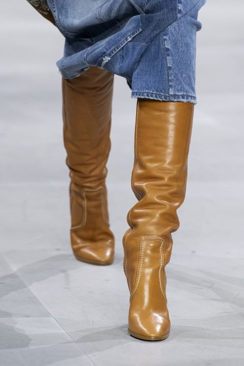 Brown, Human leg, Denim, Boot, Textile, Outerwear, Amber, Tan, Leather, Riding boot,