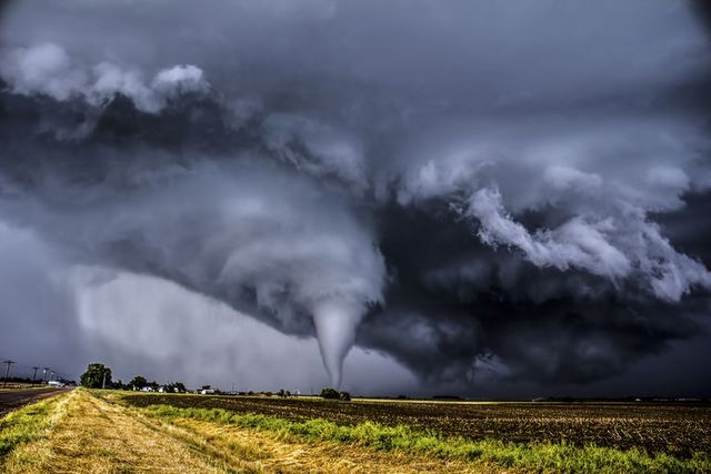 how tornadoes form, tornado seen in a field in the distance
