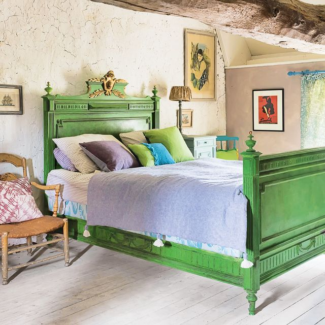 bedroom with chalk paint green bedframe in shabby chic room