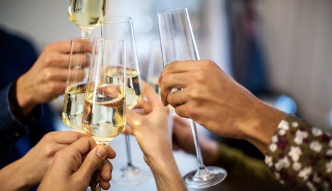 Alcohol, Drink, Alcoholic beverage, Wine glass, Champagne, Distilled beverage, Stemware, Hand, Glass, Champagne stemware,
