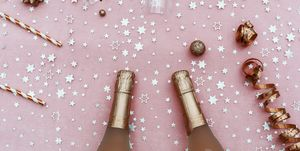 champagne and party items in pink.Top view