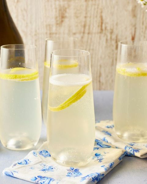 french 75 cocktail with lemon twist and blue and white napkin