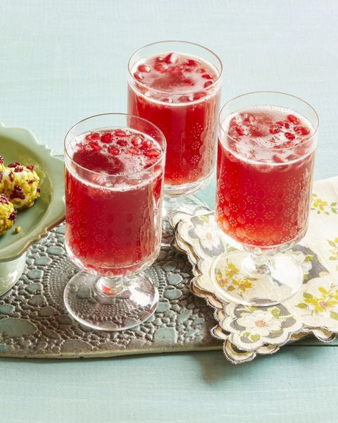 pomegranate sparklers with floral napkin and snacks on tray
