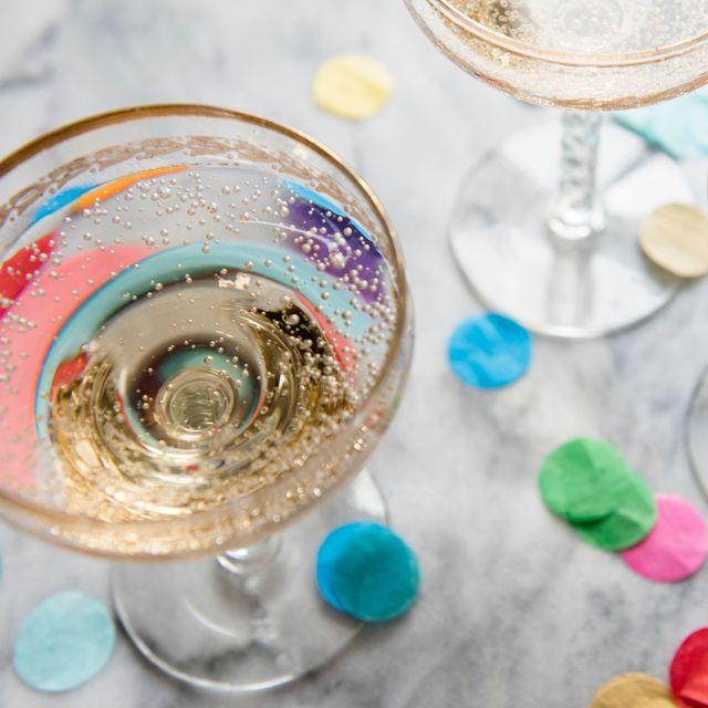 champagne coupe glasses with confetti