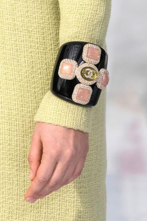 Pink, Yellow, Beige, Hand, Fashion accessory, Design, Wrist, Button, Finger, Dress,