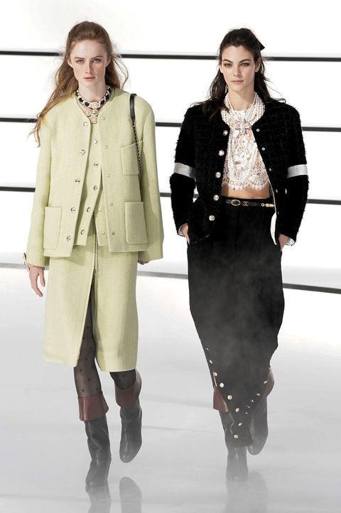 Fashion, Fashion show, Fashion model, Clothing, Runway, Outerwear, Knee, Overcoat, Winter, Beige,