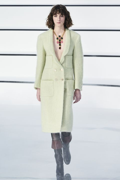 Clothing, Fashion, Fashion model, Fashion show, Outerwear, Neck, Overcoat, Runway, Haute couture, Formal wear,