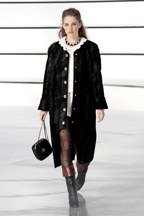 Clothing, Fashion show, Fashion, Fashion model, Runway, Outerwear, Street fashion, Coat, Overcoat, Fur,