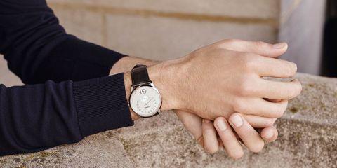 Wrist, Watch, Analog watch, Hand, Arm, Finger, Fashion accessory, Gesture, Strap, Beige,
