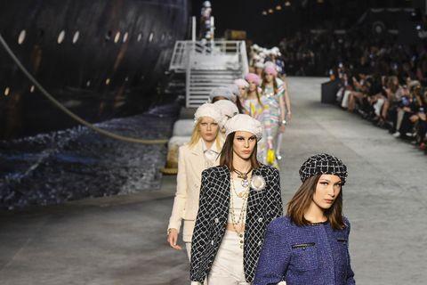 Fashion, Yellow, Street fashion, Fashion design, Runway, Headgear, Fashion show, Footwear, Event, Winter,