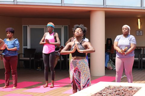 chare'a leading a meditation session at melanin girl's club