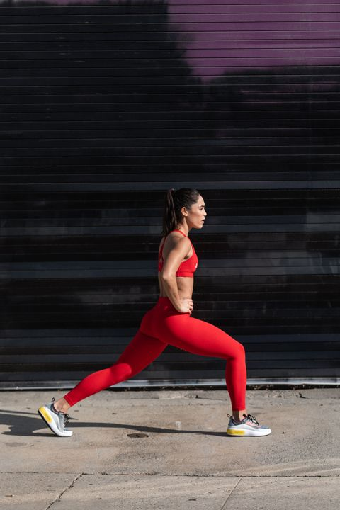 Red, Running, Leg, Physical fitness, Lunge, Recreation, Exercise, Stretching, Sports, Sportswear,