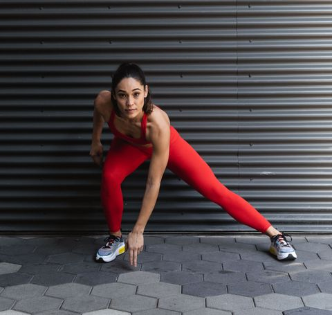 Red, Human leg, Leg, Beauty, Wall, Stretching, Shoulder, Joint, Knee, Sitting,