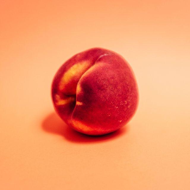 a peach symbolizing a butt