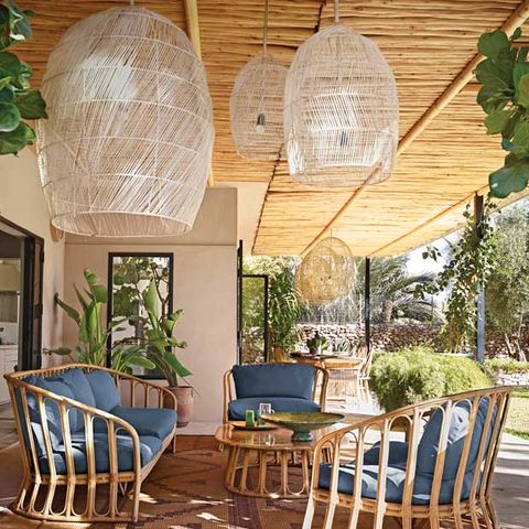 Outdoor terrace with wooden seating and large pendant lights