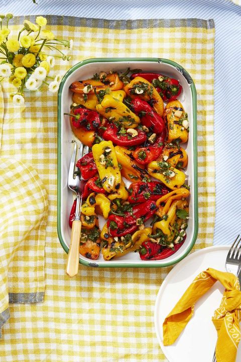 charred baby peppers with lime and cashew vinaigrette and cilantro