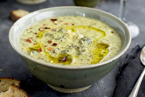 charred broccoli cheddar potato soup drizzeled with olive oil and sprinkled with red chili flakes with crostini