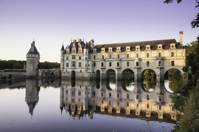 chateau de chenonceau glowing in the sunset, loire valley, france