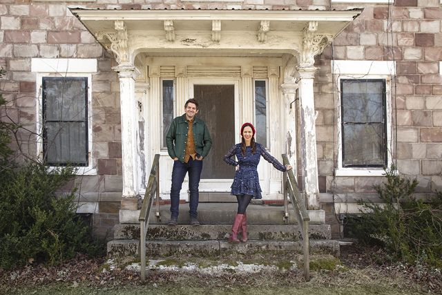 as seen on hgtv's cheap old houses, hosts ethan and elizabeth pose for a portrait at a historical home in gasport, ny