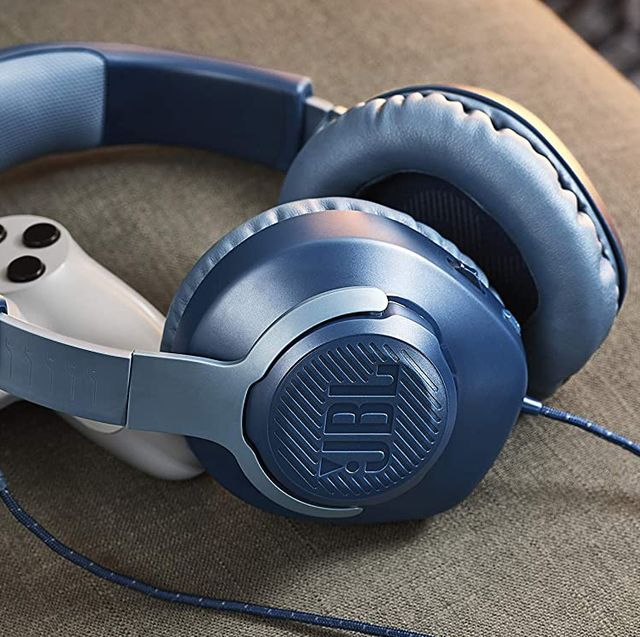 jbl headphones next to gaming controller on couch