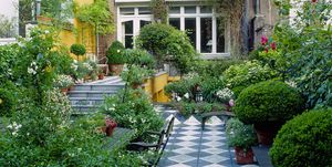 Checkered tiles in patio - long and narrow garden
