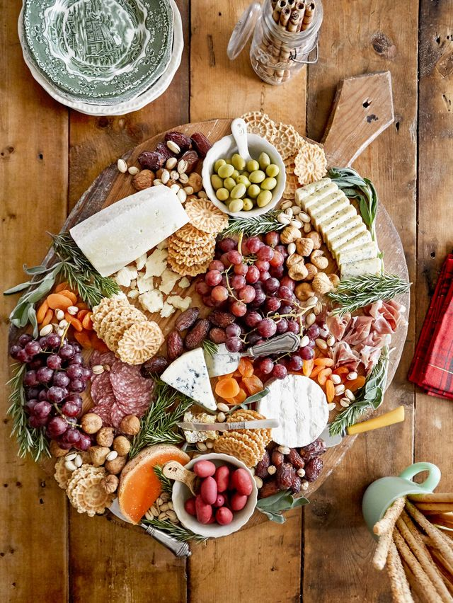 a charcuterie board with crackers cheese and fruits