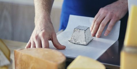 cheeseseller wrapping up goats cheese