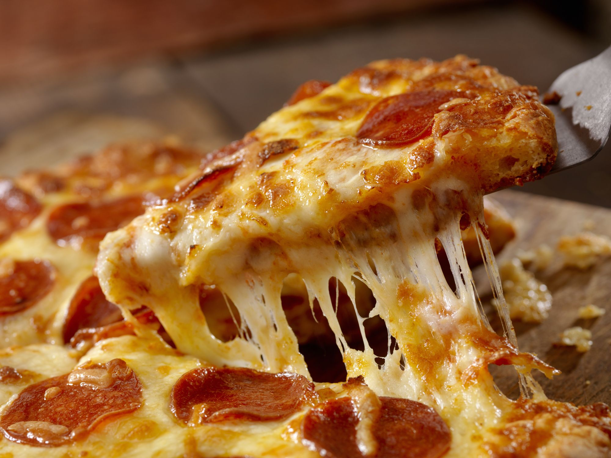 No, Pizza Chains Are Not Using Glue To Make Cheese Pulls Stretchier