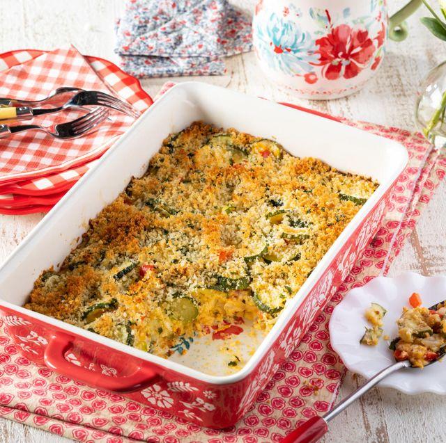 cheesy zucchini casserole in red dishes