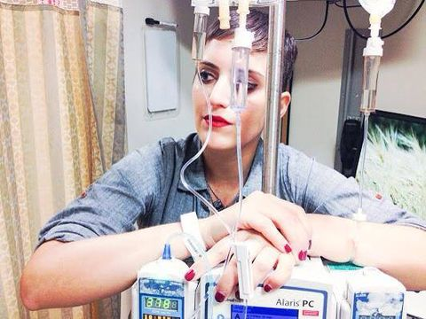 suleika is seen standing with her chemo machines