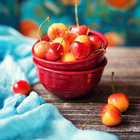 cherries in red bowl