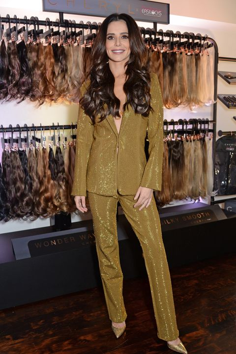 Cheryl wearing a gold suit