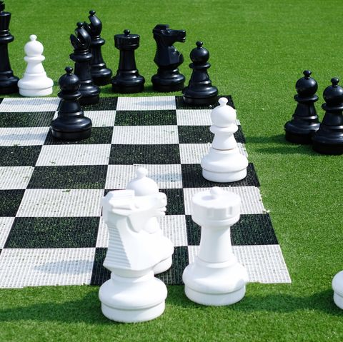 chess pieces and board on lawn